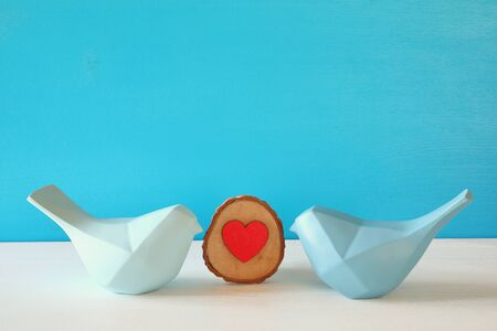 Couple of Lovebirds on wooden table.