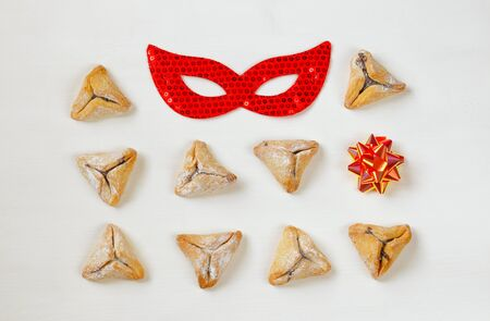 hamantasch: Purim celebration concept (jewish carnival holiday). Top view on white background Stock Photo