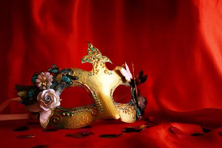 silks: elegant venetian mask on red silk Stock Photo