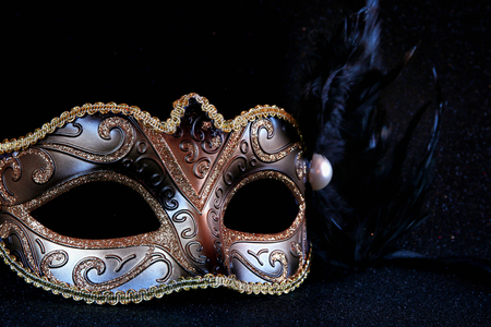 party night: Image of black elegant venetian mask on glitter background