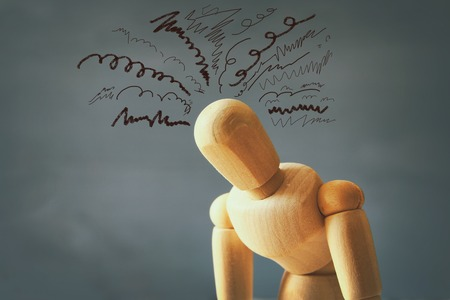 image of wooden dummy with worried stressed thoughts. depression, obsessive compulsive, adhd, anxiety disorders concept Stockfoto