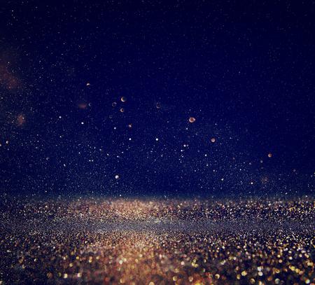 glitter vintage lights background. gold, blue and black. de-focused