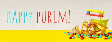 Purim celebration concept (jewish carnival holiday). Website banner format