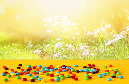 Party table with candies in front of blurry background. Stock Photo