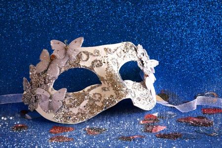 mardigras: Image of white elegant venetian mask on blue glitter background Stock Photo