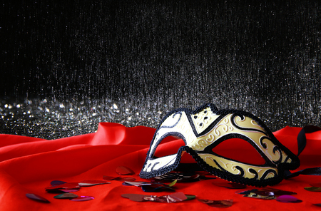 mardigras: Image of elegant venetian mask on red silk and glitter shiny background