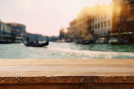 Empty table in front of blurry romantic venice background. For product display montage Stock Photo