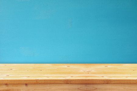 aqua background: Empty table in front of blue wooden background. For product display montage Stock Photo