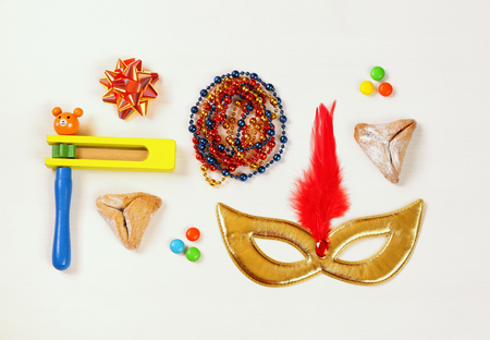 Purim celebration concept (jewish carnival holiday). Top view on white background Stock Photo