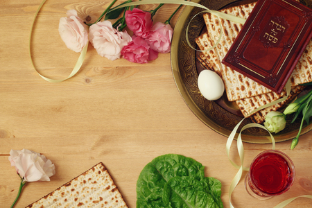 Pesah celebration concept (jewish Passover holiday). Traditional book with text in hebrew: Passover Haggadah (Passover Tale) Stock Photo
