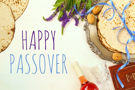matzoh: Pesah celebration concept (jewish Passover holiday). Traditional book with text in hebrew: Passover Haggadah (Passover Tale) Stock Photo