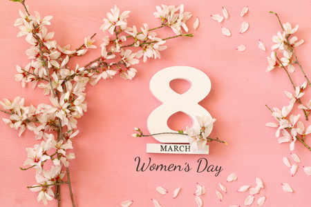 International women day concept. Cherry tree and date. Top view image Stock Photo