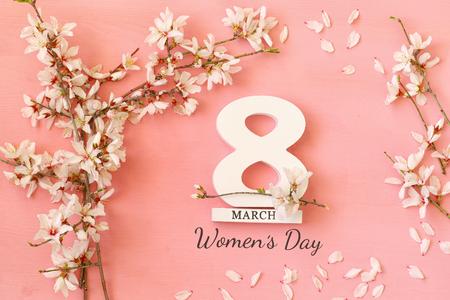 International women day concept. Cherry tree and date. Top view image Standard-Bild