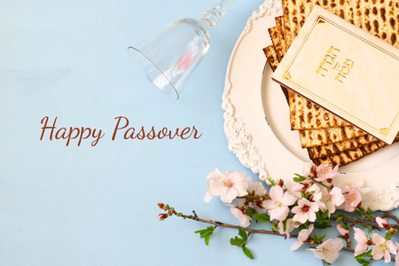 Pesah celebration concept (jewish Passover holiday). Traditional book with text in hebrew: Passover Haggadah (Passover Tale) Stock Photo - 71662343