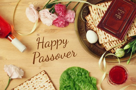 pesakh: Pesah celebration concept (jewish Passover holiday). Traditional book with text in hebrew: Passover Haggadah (Passover Tale) Stock Photo