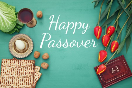 Pesah celebration concept (jewish Passover holiday). Traditional book with text in hebrew: Passover Haggadah (Passover Tale) Reklamní fotografie - 72481175