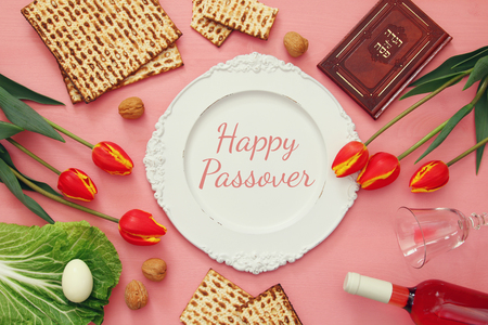 pesah: Pesah celebration concept (jewish Passover holiday). Traditional book with text in hebrew: Passover Haggadah (Passover Tale) Stock Photo