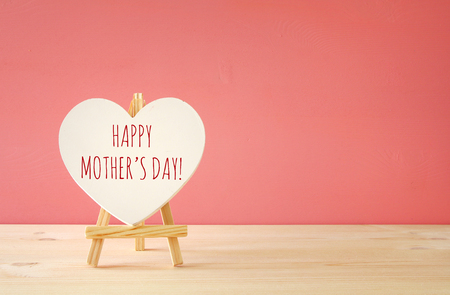 mothers day concept image. Board by heart shape.