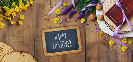 matzoth: Pesah celebration concept (jewish Passover holiday). Traditional book with text in hebrew: Passover Haggadah (Passover Tale). Website format