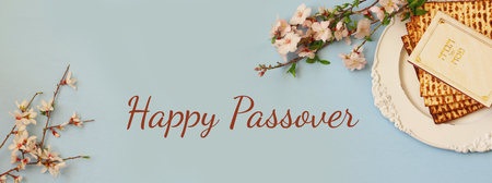 Pesah celebration concept (jewish Passover holiday). Traditional book with text in hebrew: Passover Haggadah (Passover Tale). Website format