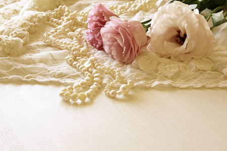 neckless: Background of white delicate lace fabric and white flowers