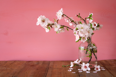 spring bouquet of cherry tree branches on the wooden table