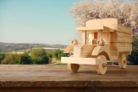 nostalgy: old wooden toy truck car over wooden table. nostalgia and simplicity concept. vintage style image