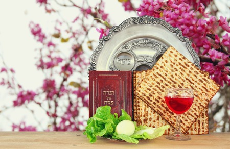matzah: Pesah celebration concept (jewish Passover holiday). Traditional book with text in hebrew: Passover Haggadah (Passover Tale) Stock Photo