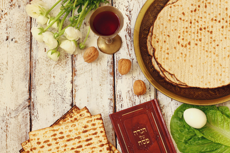 matzoth: Pesah celebration concept (jewish Passover holiday). Traditional book with text in hebrew: Passover Haggadah (Passover Tale) Stock Photo