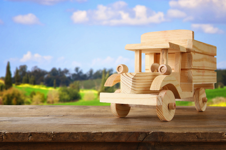 old wooden toy truck car over wooden table. nostalgia and simplicity concept. vintage style image