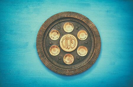 matzoth: Pesah celebration concept (jewish Passover holiday). Traditional pesah plate text in hebrew: Passover, horseradish, celery, egg, bone, maror, charoset