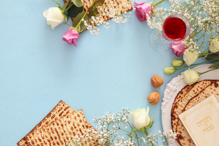Pesah celebration concept (jewish Passover holiday). Traditional book with text in hebrew: Passover Haggadah (Passover Tale) Фото со стока