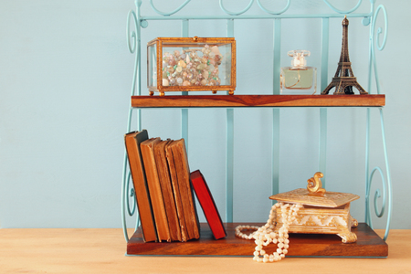 vintage objects: Classic shelf with vintage objects on wooden table.