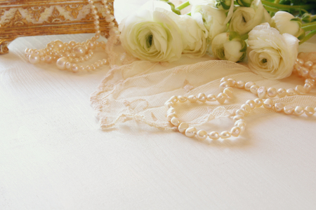 Background of white delicate lace fabric and white flowers