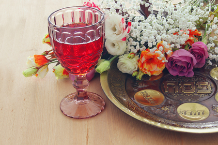Pesah celebration concept (jewish Passover holiday). Traditional plate with text in hebrew: Passover