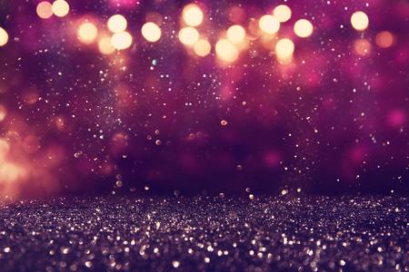 metalic texture: glitter vintage lights background. gold, purple and black. de-focused. Stock Photo