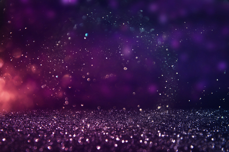 glitter vintage lights background. gold, purple and black. de-focused. Stok Fotoğraf
