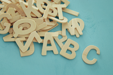 Set of a wooden letters of the English alphabet on wooden blue background
