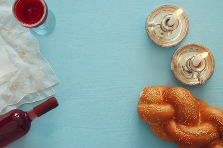 shabbat image. challah bread, shabbat wine and candles. Top view Zdjęcie Seryjne