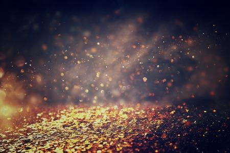 metalic: glitter vintage lights background. gold and black. de-focused.