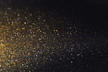 metalic texture: glitter vintage lights background. gold and black. de-focused.