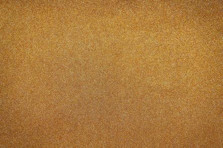 metalic: glitter vintage gold lights background. de-focused.