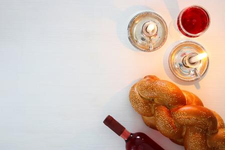 shabbat image. challah bread, shabbat wine and candles. Top view Standard-Bild
