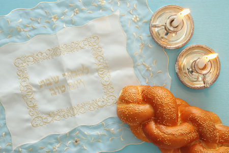 shabbat image. challah bread and candles. Top view Reklamní fotografie - 77065043