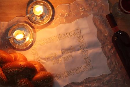 shabat: shabbat image. challah bread and candles. Top view Foto de archivo