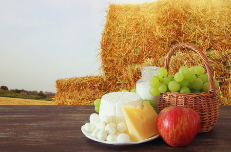 Image of dairy products and fruits on wooden table. Symbols of jewish holiday - Shavuot 版權商用圖片