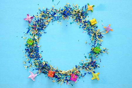 party blue background with colorful confetti.