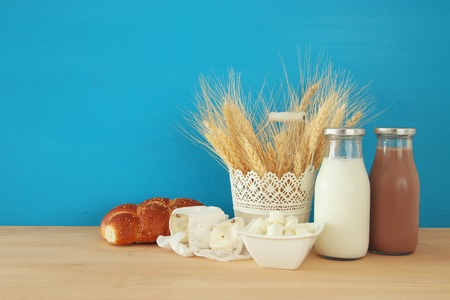 image of dairy products on wooden table. Symbols of jewish holiday - Shavuot Stock Photo