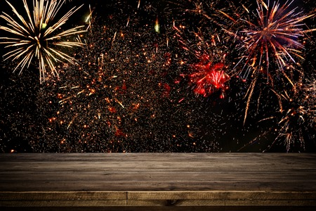Empty wooden table in front of fireworks background. Product display montage Stock Photo