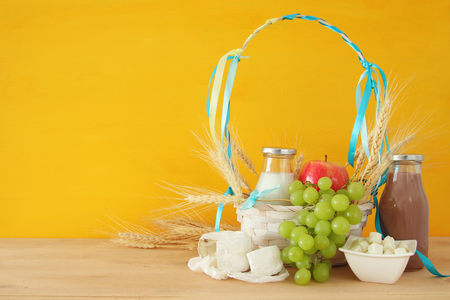 Image of dairy products and fruits on wooden table. Symbols of jewish holiday - Shavuot Stock Photo